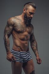 Fashionable nude bearded man.