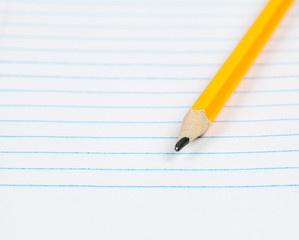 Yellow pencil on notebook