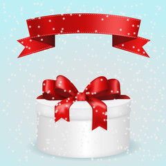 Winter background with Gift box. Round gift box with red flat ribbon and snow.