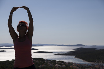 Pretty woman, silhouette, enyojing, excercising on sea coast in Kornati national park, paradise islands, archipelago in Dalmatia, Croatia, space for text