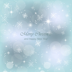 Merry Christmas and Happy New Year blue greeting card with snow, snowflakes and glow.