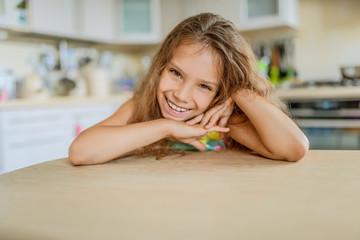 Little pretty girl on kitchen
