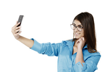 Young, beautiful business woman taking a selfie with smartphone