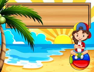 Little sitting on the beach
