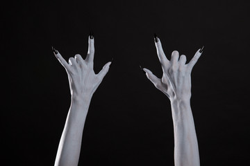 Pale ghost hands showing heavy metal sign