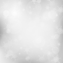 Christmas silver blurred background with snowflakes