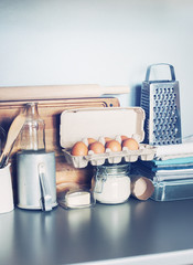 Eggs, Table Ware, Grocery, Different Stuff on Kitchen Table-top. Toned image