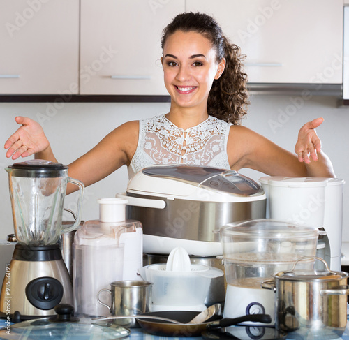 """Happy Girl Kitchen: """"Happy Girl Posing With Appliances At Kitchen"""" Stock Photo"""