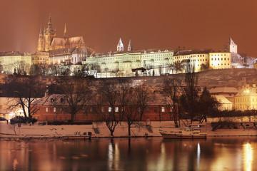 Night colorful romantic snowy Prague gothic Castle above River Vltava, Czech republic