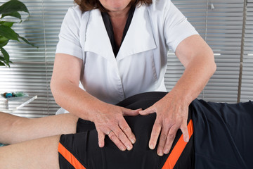 Female Physiotherapist working on the leg of a man