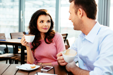 Young couple having a conversation over a cup of coffee