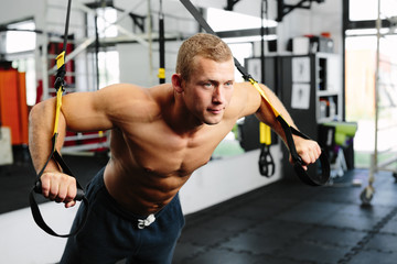 Muscular man working out his arms