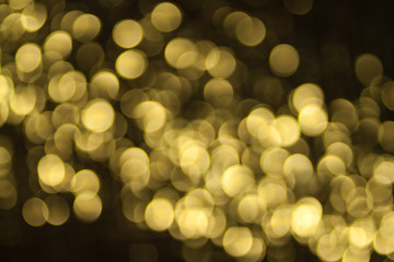 Vintage bokeh background. Gold retro bokeh. Fairy defocused backdrop. Hipster photo wallpaper. Chicago style. Party invitation template. Celebration wallpaper. Blurry lights.