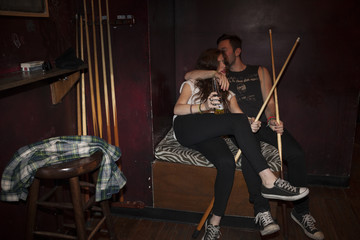 Young couple hanging out at a pool hall