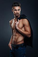 Handsome man shirtless posing in the studio