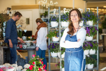 Portrait Of Smiling Female Owner In Flower Shop