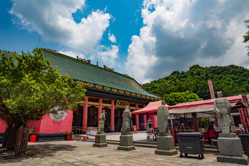 "HONG KONG, CHINA - August 6, 2015 : View of The ancient chinese temple ""Che Kung Temple"" under cloudy sky on Aug 6, 2015 in Hong Kong"