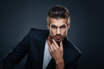 Portrait of handsome man in a studio on a dark background Wall mural