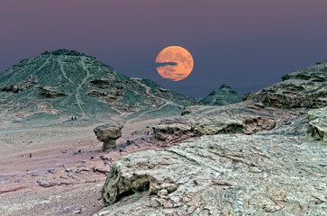 Rise of super-moon in geological nature park Timna