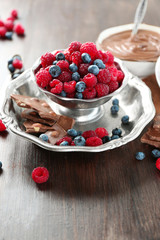 Beautiful composition with chocolate cream and ripe berries
