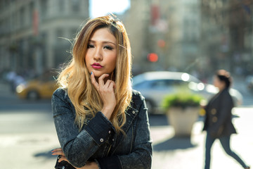 Young Asian woman posing in city