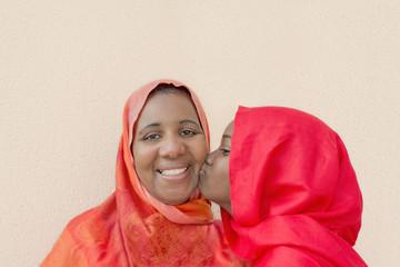 A big kiss on mummy's cheek