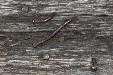 striped texture of old wood with rusty nails natural background