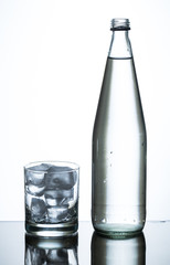 bottle of water and glass of ice
