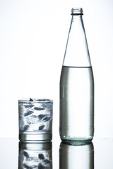 bottle of water and glass of iced water