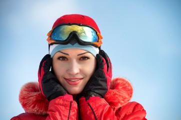 Closeup portrait of a smiling girl wearing ski glasses