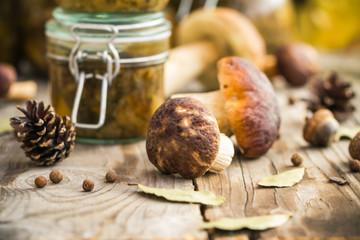 Marinated mushrooms jars wooden table