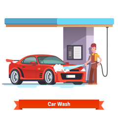 Car wash specialist washing red sports car