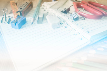 Abstract School and office supplies on wood background. Back to