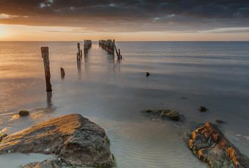 Old broken pier at dawn, Baltic Sea