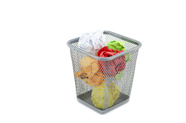 green,red,white,and yellow crumple paper on metal dustbin.isolated white background