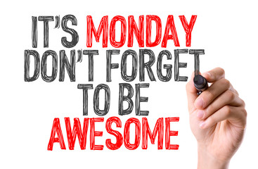 Hand with marker writing: Its Monday Don't Forget to be Awesome