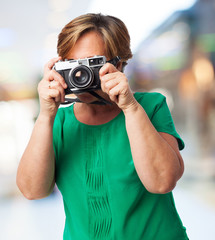 portrait of a mature woman ready to take a photo
