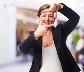 portrait of a mature business woman doing a frame gesture