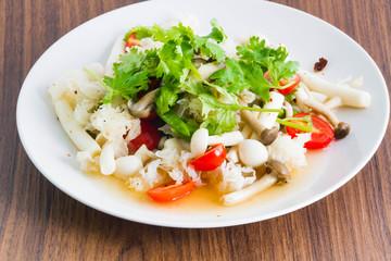 Mushroom spicy salad on the wood background - Vegetarian Food