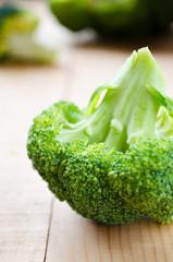 raw fresh green broccoli on wood table