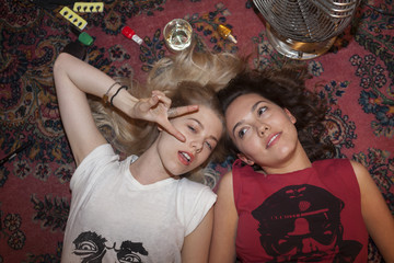 Young women relaxing on floor