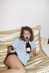 Young woman enjoying a bottle of wine