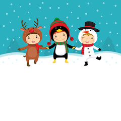 Happy kids in Christmas costumes playing with snow