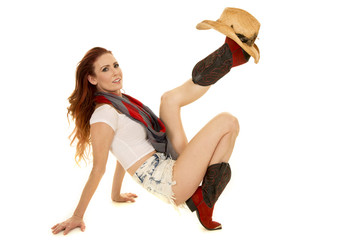 cowgirl with red hair hat on boot
