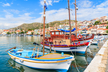 Traditional colourful Greek fishing boats in Pythagorion port, Samos island, Greece