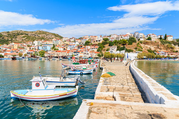 A view of Pythagorion port with traditional colourful Greek fishing boats, Samos island, Greece