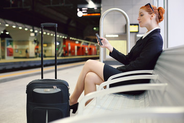 Beautiful businesswoman waiting at train station