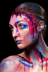 Girl painted different colors
