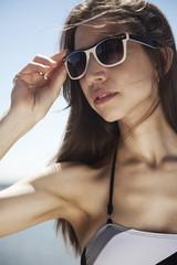 Sexy woman wearing bikini and sunglasses