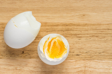 Two boiled eggs on a wooden background